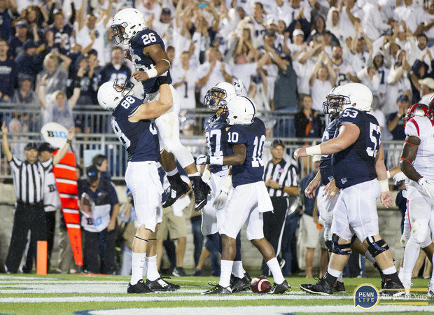 Saquon Barkley celebrates with his teammates after a second quarter touchdown